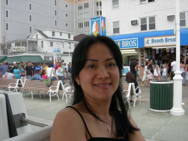 Filipino American woman at Ocean city beach